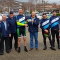 John, Clive and Steve presenting a cheque to members of Whitland Male Voice Choir during their sponsored bike ride from Whitland to the Royal Albert Hall, in aid of Prostate Cancer research.